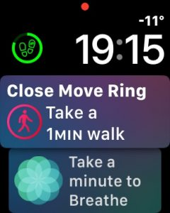 Siri Watch Face suggesting how much movement is required to close my move ring.